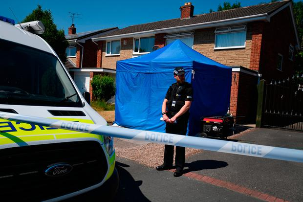 A police officer stands outside a house in Chester which is being investigated as part of the probe into the deaths of 17 babies Photo: Getty Images