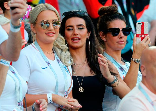 Megan Davison, girlfriend of England goalkeeper Jordan Pickford (left) Annie Kilner, girlfriend of England's Kyle Walker (centre) and Rebekah Vardy, wife of England's Jamie Vardy during the FIFA World Cup Group G match at Kaliningrad Stadium