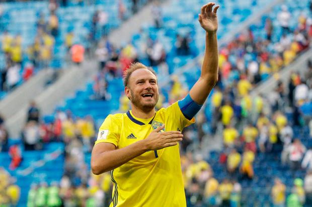 Sweden's Andreas Granqvist waves to the fans after the round of 16 match between Switzerland and Sweden