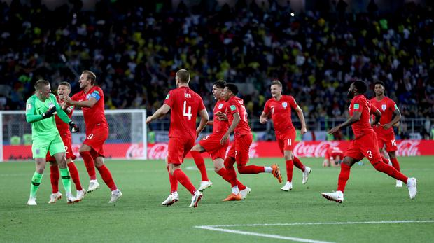 England players celebrate winning the penalty shoot-out against Colombia (Tim Goode/PA)