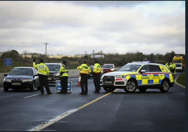 Gardai at the scene of a checkpoint. Stock image