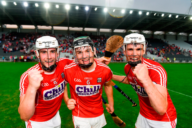 Cork players, from left, Eoghan Murphy, Mark Coleman and David Griffin celebrate