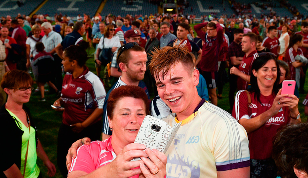 Jack Canning of Galway poses for a selfie with a supporter