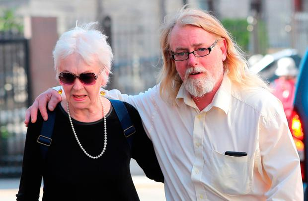 Tressa Donnelly Reeves and her son Andre Reeves, who was previously named Patrick Farrell, at the High Court. Picture: PA