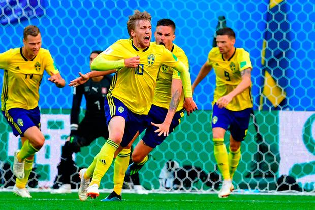 Emil Forsberg (2nd L) celebrates after scoring for Sweden during their World Cup round of 16 match against Switzerland in Saint Petersburg. Photo: AFP/Getty Images