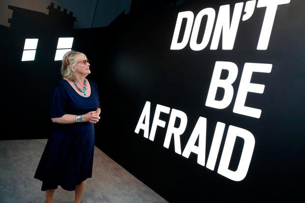 Marie Heaney, wife of Seamus Heaney, in front of a work by the artist Maser at the launch of the exhibition. Photo: Marc O'Sullivan