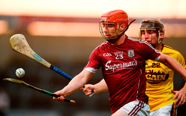 Patrick Foley of Galway in action against Darren Codd of Wexford. Photo: Sam Barnes/Sportsfile