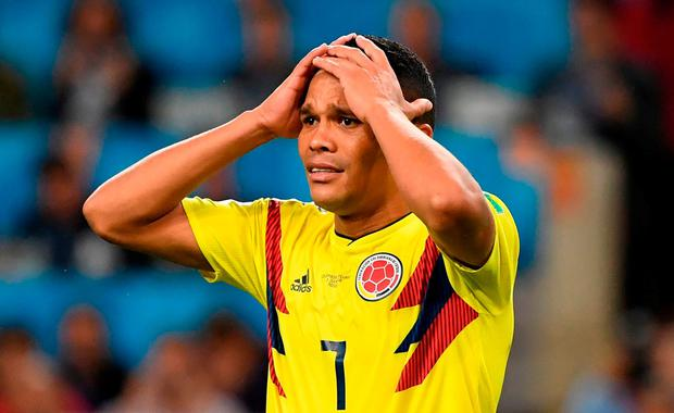 Colombia's forward Carlos Bacca reacts after his missed penalty