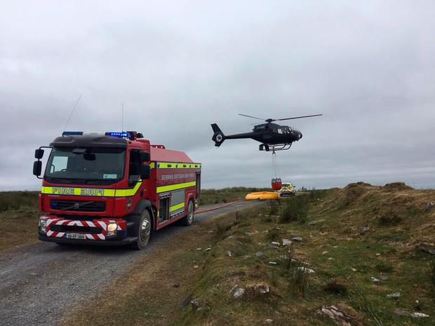 Offaly Fire and Rescue Service are working with Coilte and the Air Corps to bring the fire under control Photo: Offaly County Council