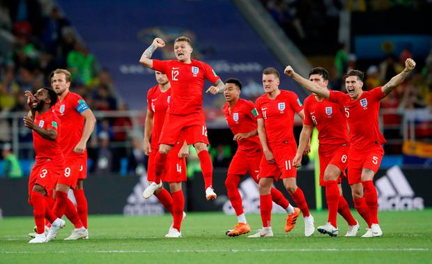 England players celebrate after beating Colombia on penalties