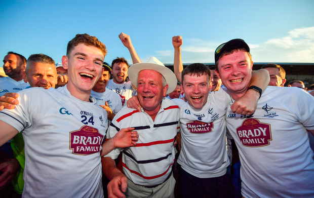 Mark Hyland of Kildare, 24, celebrates with supporters and family