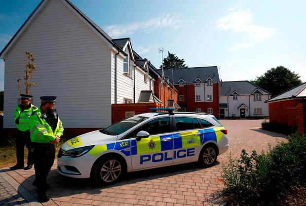Police guard the entrance to the housing estate in Amesbury where Charles Rowley and Dawn Sturgess were found. Photo: Henry Nicholls/Reuters