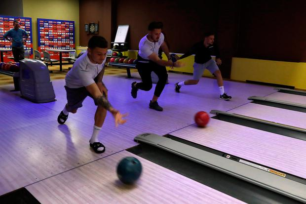 England's Kieran Trippier, Jack Butland and Jordan Henderson bowling in St Petersburg yesterday. Photo: Reuters