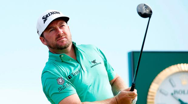 McDowell keeps himself alive after day of 'grinding'