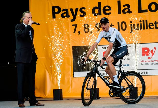 Chris Froome of Team Sky rides on the stage during the team presentations