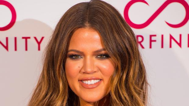 Khloe Kardashian has told fans she is dreading going back to work following the birth of her daughter (Dominic Lipinski/PA)