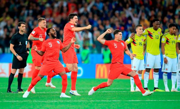 (left to right) England's Kieran Trippier, Danny Rose, Harry Maguire and John Stones celebrate winning the penalty shootout