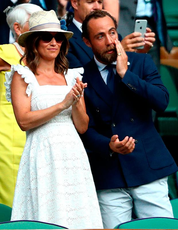 Pippa Matthews and James Middleton applaud Kyle Edmund after his win on centre court on day four of the Wimbledon Championships at the All England Lawn Tennis and Croquet Club, Wimbledon