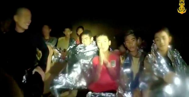 Boys from the under-16 soccer team trapped inside Tham Luang cave greet members of the Thai rescue team in Chiang Rai, Thailand