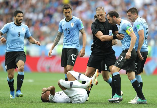 Referee Nestor Pitana stops Diego Godin of Uruguay from arguing with Kylian Mbappe of France during the 2018 FIFA World Cup Russia Quarter Final match between Uruguay and France.