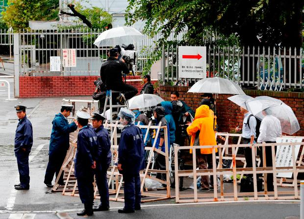 Journalists and policemen stand in front of Tokyo Detention Centre where former leader of Aum, the Japanese doomsday cult, Chizuo Matsumoto, who went by the name Shoko Asahara, was executed. Photo: Reuters