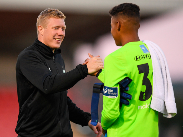 Shamrock Rovers' Gavin Bazunu is congratulated by Kevin Horgan. Photo: Sportsfile