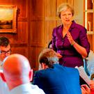 British Prime Minister Theresa May sets out her Brexit plans as Brexiteer minister Penny Mordaunt (left) watches on, arms crossed during a Cabinet meeting at Chequers. Picture: PA