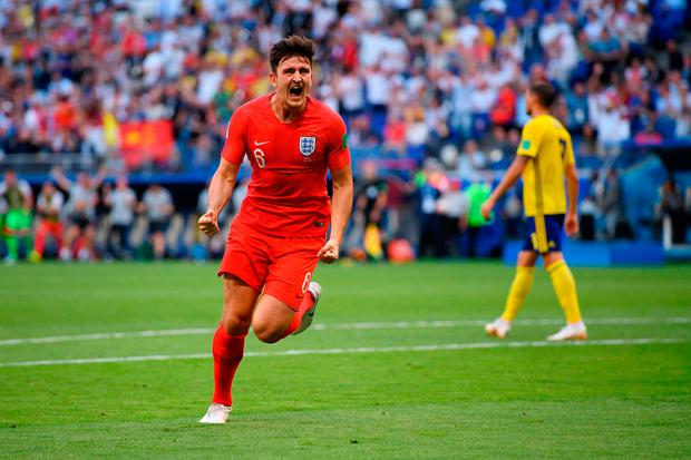 SAMARA, RUSSIA - JULY 07: Harry Maguire of England celebrates after scoring his team's first goal during the 2018 FIFA World Cup Russia Quarter Final match between Sweden and England at Samara Arena on July 7, 2018 in Samara, Russia. (Photo by Matthias Hangst/Getty Images)