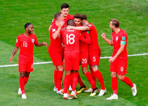 England's Dele Alli celebrates with team mates after scoring their second goal