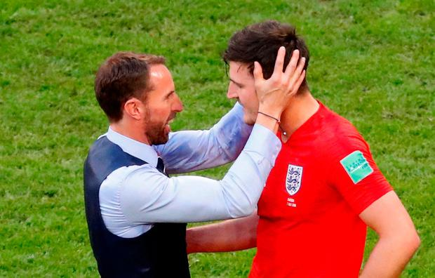 England's Harry Maguire celebrates victory with manager Gareth Southgate after the match