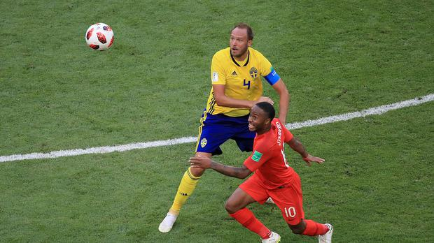 Sweden's Andreas Granqvist (left) and England's Raheem Sterling battle for the ball (PA)