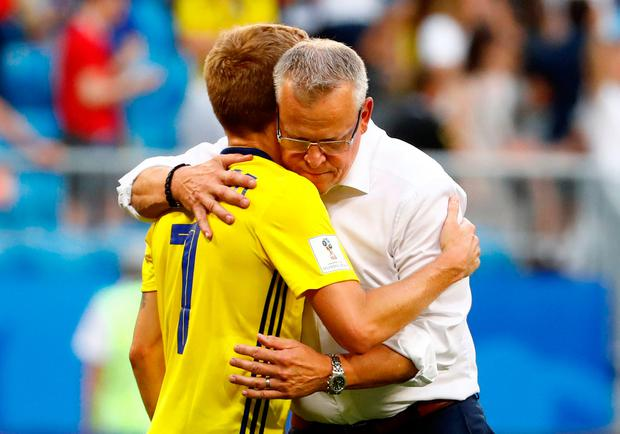 Sweden coach Janne Andersson embraces Sebastian Larsson after the match