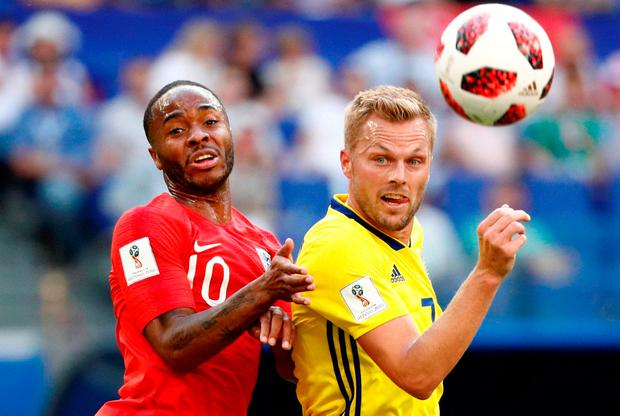 England's Raheem Sterling battles with with Sweden's Sebastian Larsson. Photo: Max Rossi/Reuters