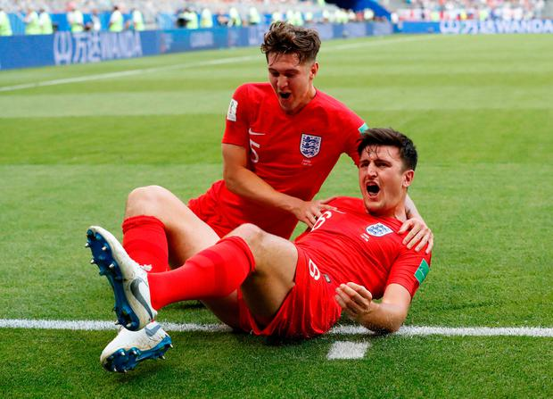 England's Harry Maguire celebrates with John Stones after scoring his side's first goal. Photo: Carlos Garcia Rawlins/Reuters