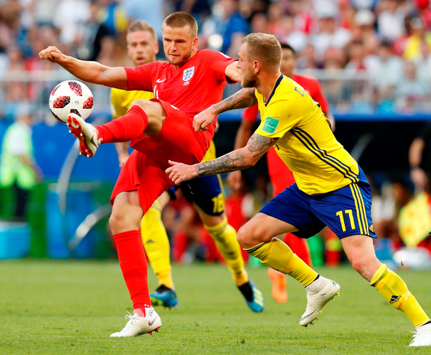 England's Eric Dier is challenged by Sweden's John Guidetti. Photo: Carlos Garcia Rawlins/Reuters