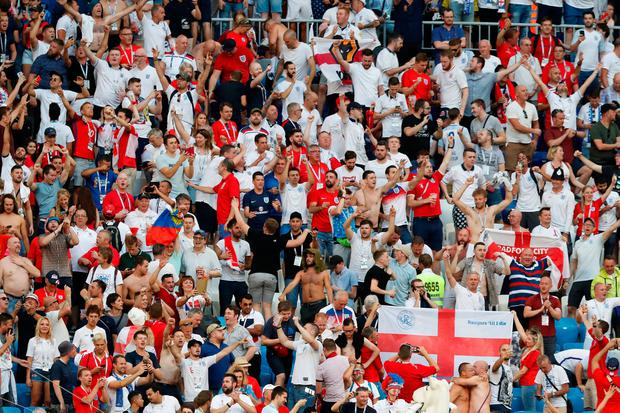 England fans celebrate after the match against Sweden. Photo: Carlos Garcia Rawlins/Reuters