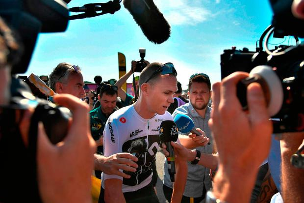 Reporters surround Team Sky's Chris Froome prior to the first stage of the Tour de France yesterday. Photo: Getty Images