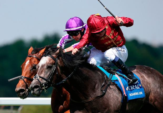 Roaring Lion ridden by Oisin Murphy (front) get the better of Saxon Warrior ridden by Donnacha O' Brien to win The Coral-Eclipse Race at Sandown. Photo: Julian Herbert/PA