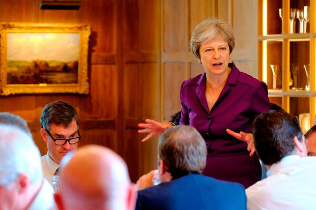 Theresa May speaking during a cabinet meeting at Chequers yesterday. A new UK-European Union free trade area for goods will be created under Brexit plans thrashed out by ministers at the meeting. Photo: Joel Rouse/PA