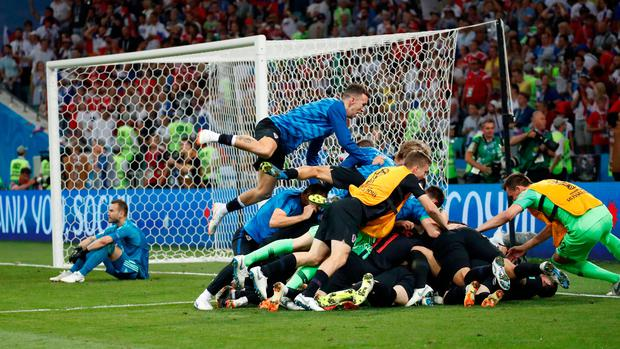 Croatia's Ivan Rakitic celebrates with team mates after scoring the deciding penalty