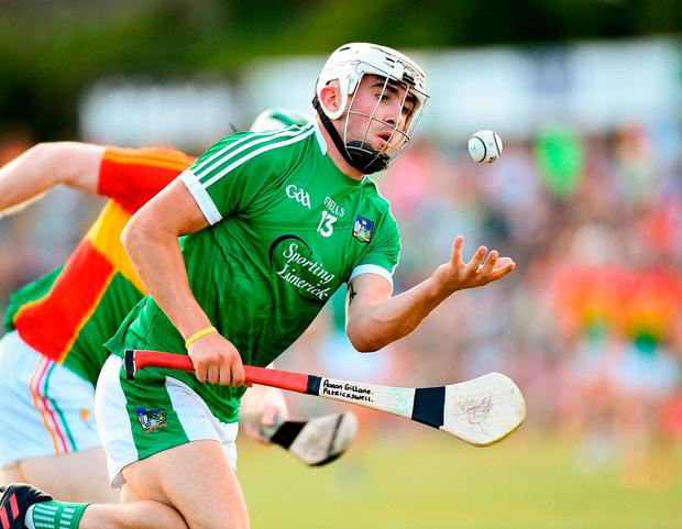 Aaron Gillane of Limerick in action against Paul Doyle of Carlow. Photo: Matt Browne/Sportsfile