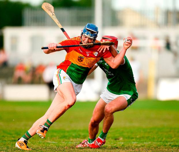 Diarmuid Byrne of Carlow in action against Barry Nash of Limerick. Photo: Matt Browne/Sportsfile