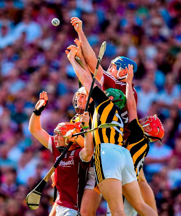 Galway and Kilkenny players compete for a high ball. Photo: Stephen McCarthy/Sportsfile