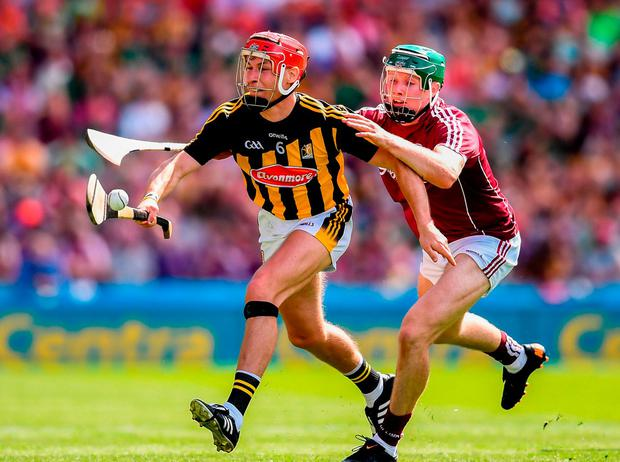 Cillian Buckley tries to get away from Cathal Mannion. Photo: Stephen McCarthy/Sportsfile