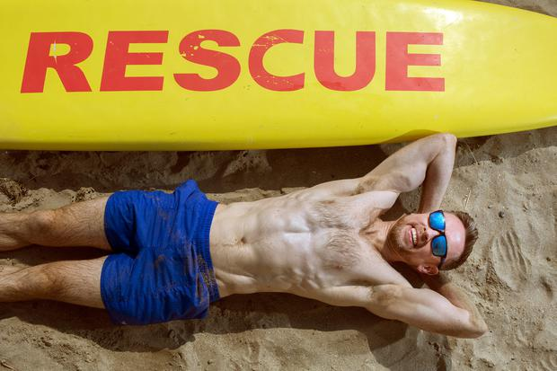 HOT TOPIC: Laid-back 'Sunday Independent' writer Donal Lynch shows off his fab abs in the sun. Photo: Tony Gavin