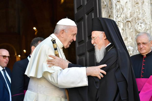 EMBRACING: Pope Francis hugs Patriarch Bartolomeo I as he arrives to attend a prayer for peace in the Middle East at the St Nicholas Basilica in Bari, Italy, yesterday. Picture: Reuters