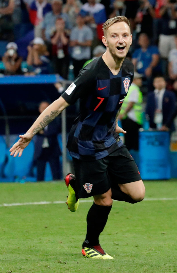 Croatia's Ivan Rakitic celebrates after scoring the winning penalty during the shootout with Russia. Photo: Reuters