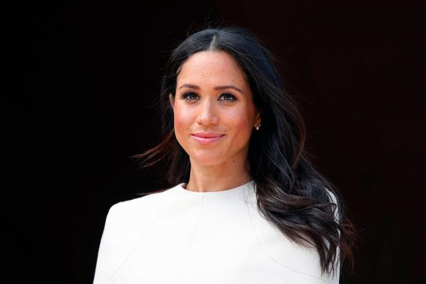 GRACE: Meghan Markle has, without doubt, an easy charm with people that we haven't seen since Diana. Picture: Getty