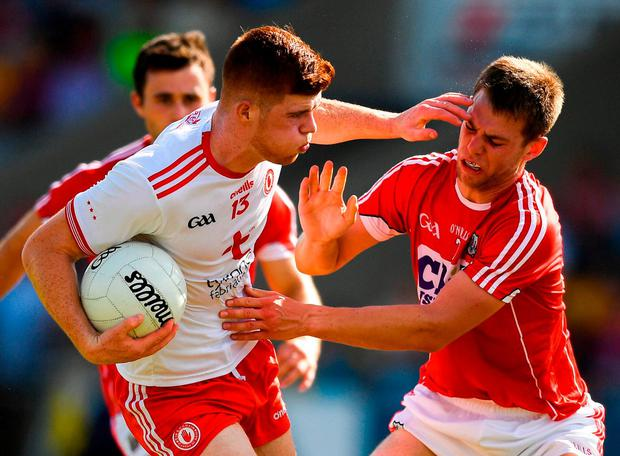 Tyrone's Cathal McShane of Tyrone holds off Cork's Cian Kelly. Photo: Eóin Noonan/Sportsfile