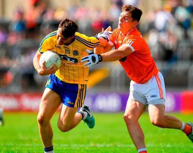 Diarmuid Murtagh of Roscommon in action against Patrick Burns of Armagh. Photo: Brendan Moran/Sportsfile
